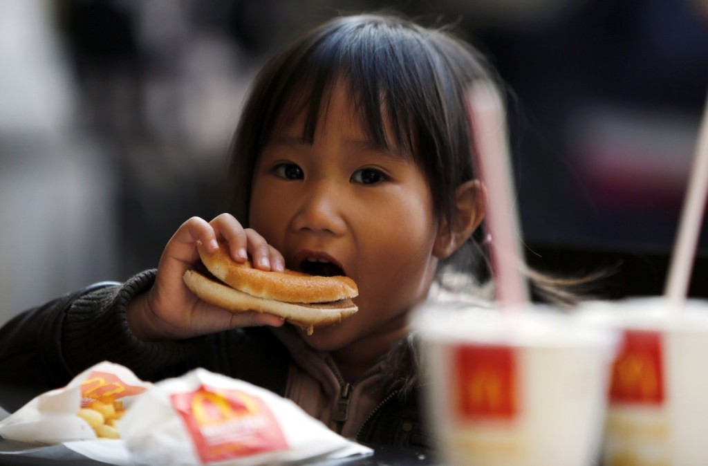 alignthoughts-mcdonald's hamburger happy meal child eating