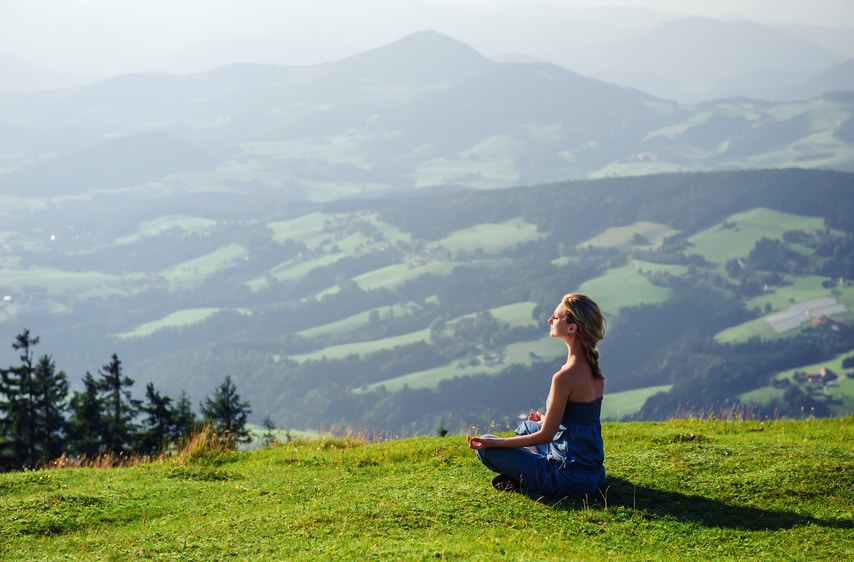 align-thoughts-Young woman meditating outdoors