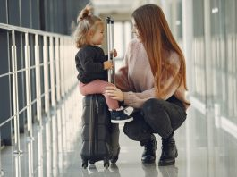 mother flying with a baby girl-alignthoughts